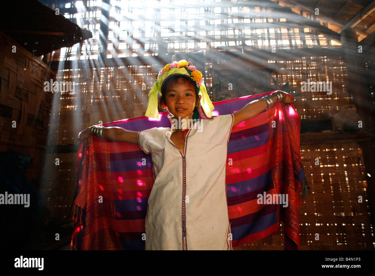 A young Longneck girl models her traditional scarf and dress Approximately  300 Burmese refugees in Thailand
