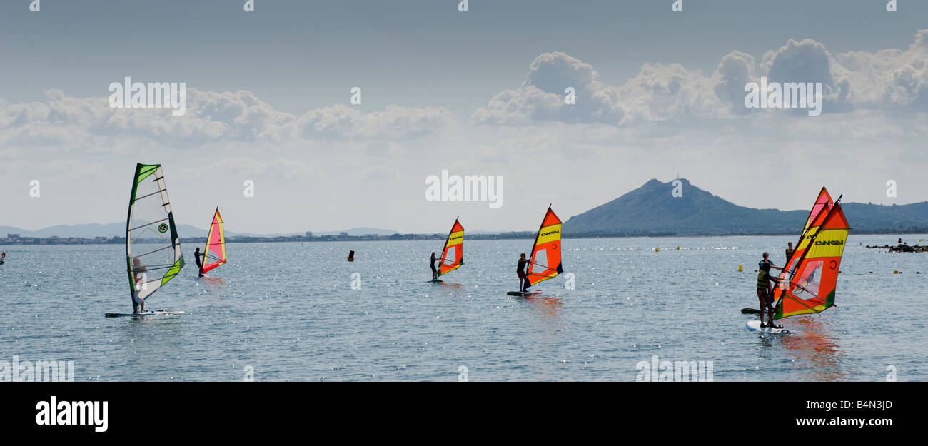 Windsurfers in widescreen format on the coast of Majorca - Stock Image
