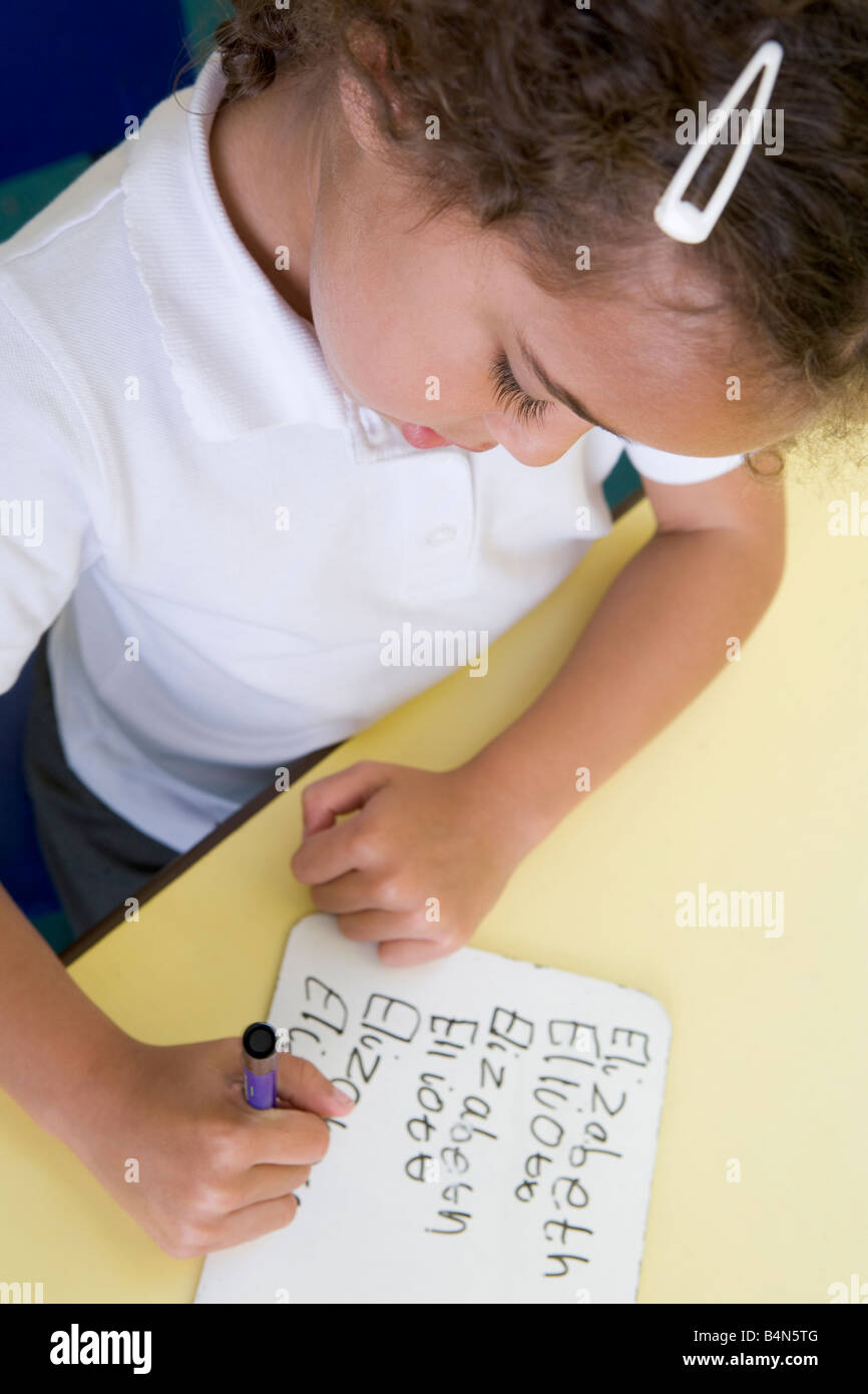 Student in class learning spelling (selective focus) - Stock Image