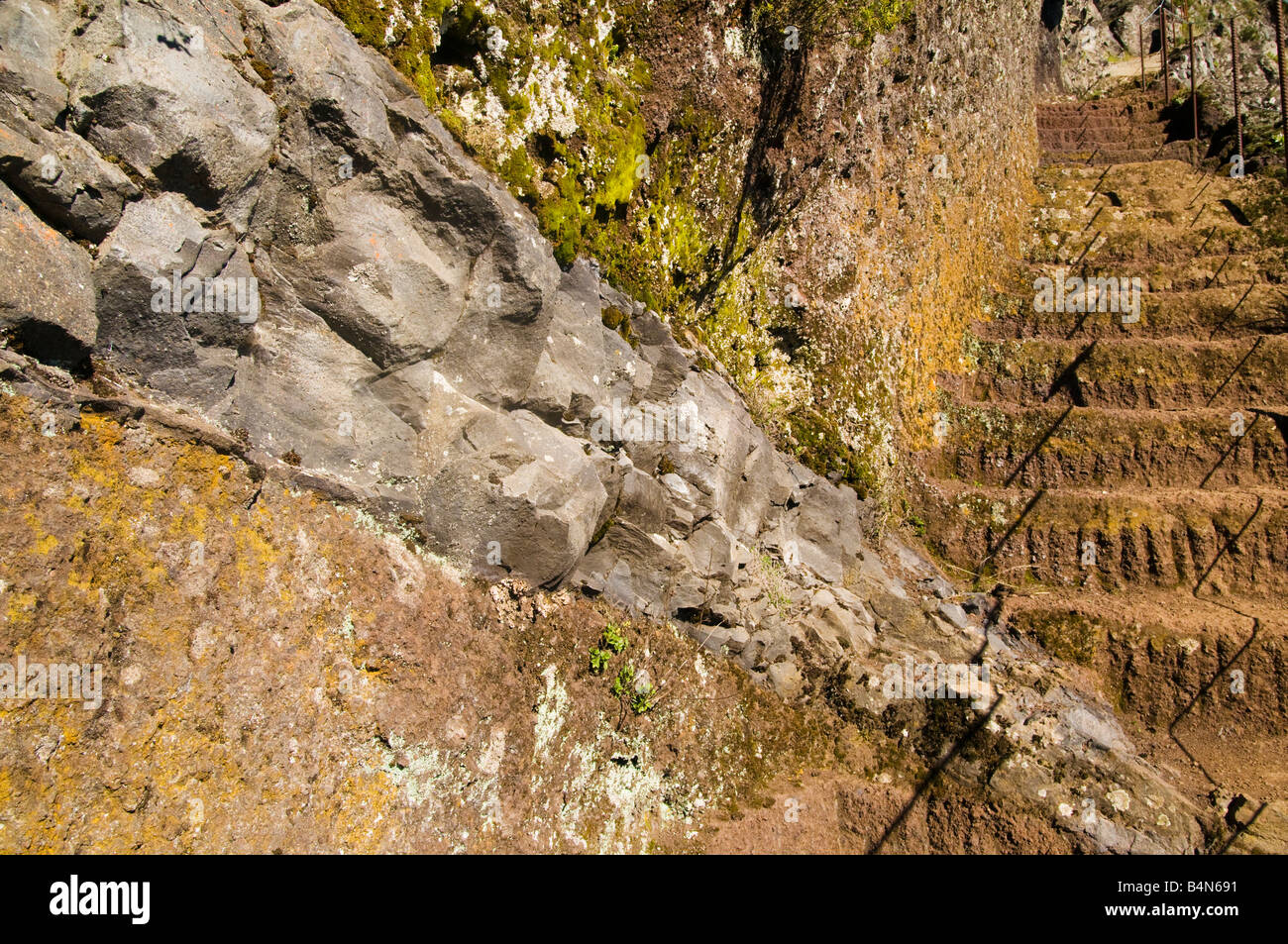 Volcanic intrusion and carved rock steps on Pico das Torres Madeira - Stock Image