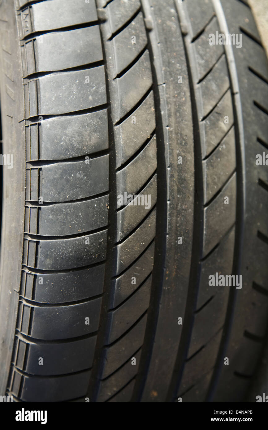 Car tyre which has worn unevenly and has failed the MOT test despite still having good tread in most areas. (40) - Stock Image