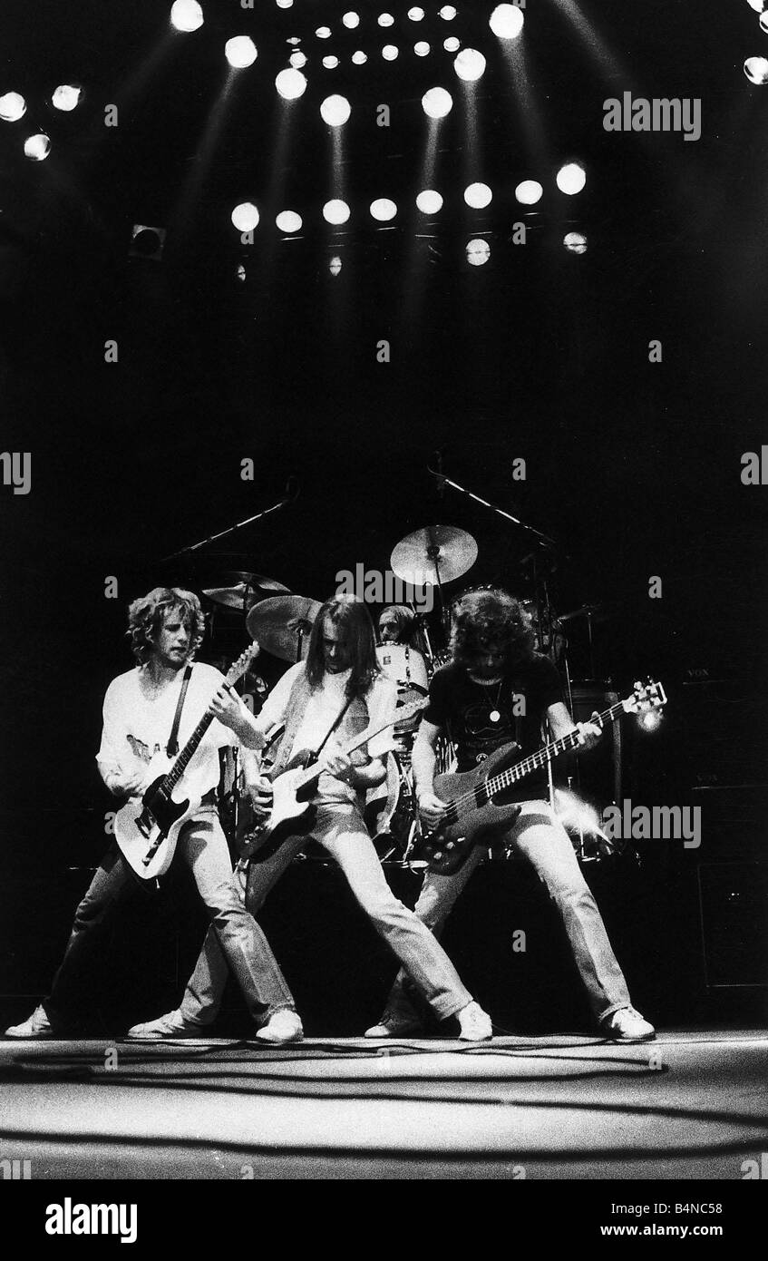 Status quo pop group singing on stage stock image