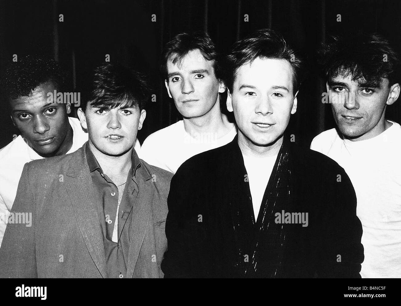 Simple Minds rock band from left Mel Gaynor Charlie Burchill Derek Forbes Jim Kerr and Mick McNeill - Stock Image