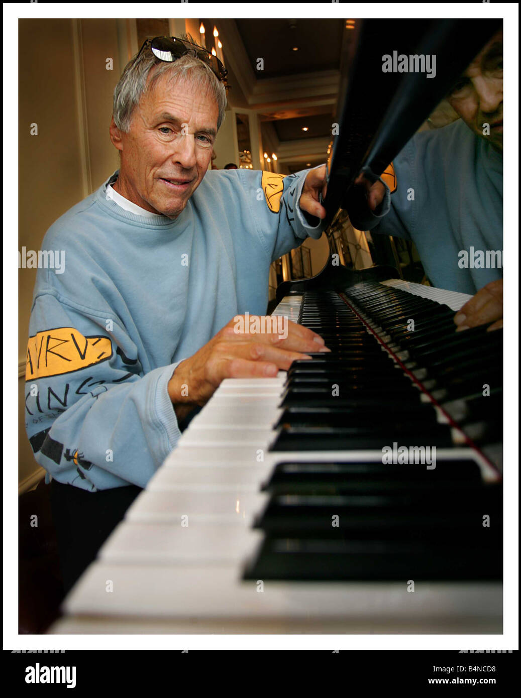 Music legend Burt Bacharach sitting at a piano at the Berkeley hotel London Burt as a new album to be released in - Stock Image