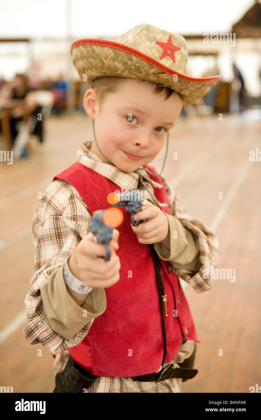 Creetown Country Music Festival young boy dressed as sheriff with guns going to shoot outlaw Galloway Scotland UK - Stock Image