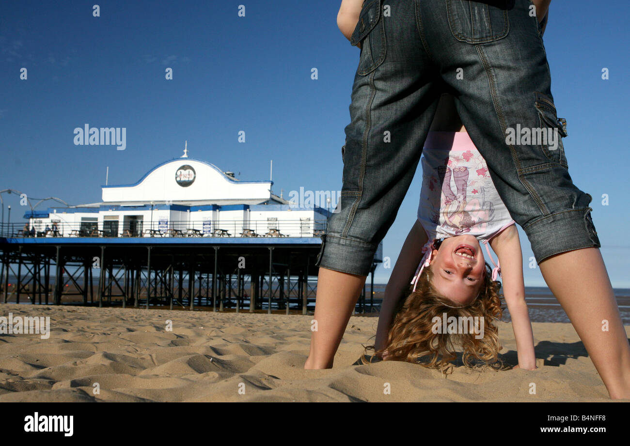 Girl and mother playing on the beach at Cleethorpes near Grimsby Humberside north east Lincolnshire holiday fun - Stock Image