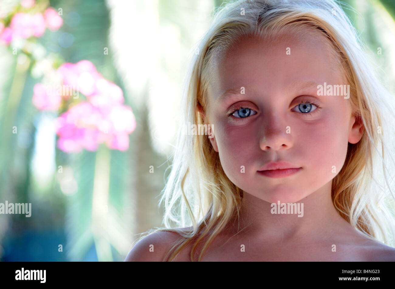 Royalty free photograph of young girl with fair light skin on summer holiday with high factor UV skin protection - Stock Image