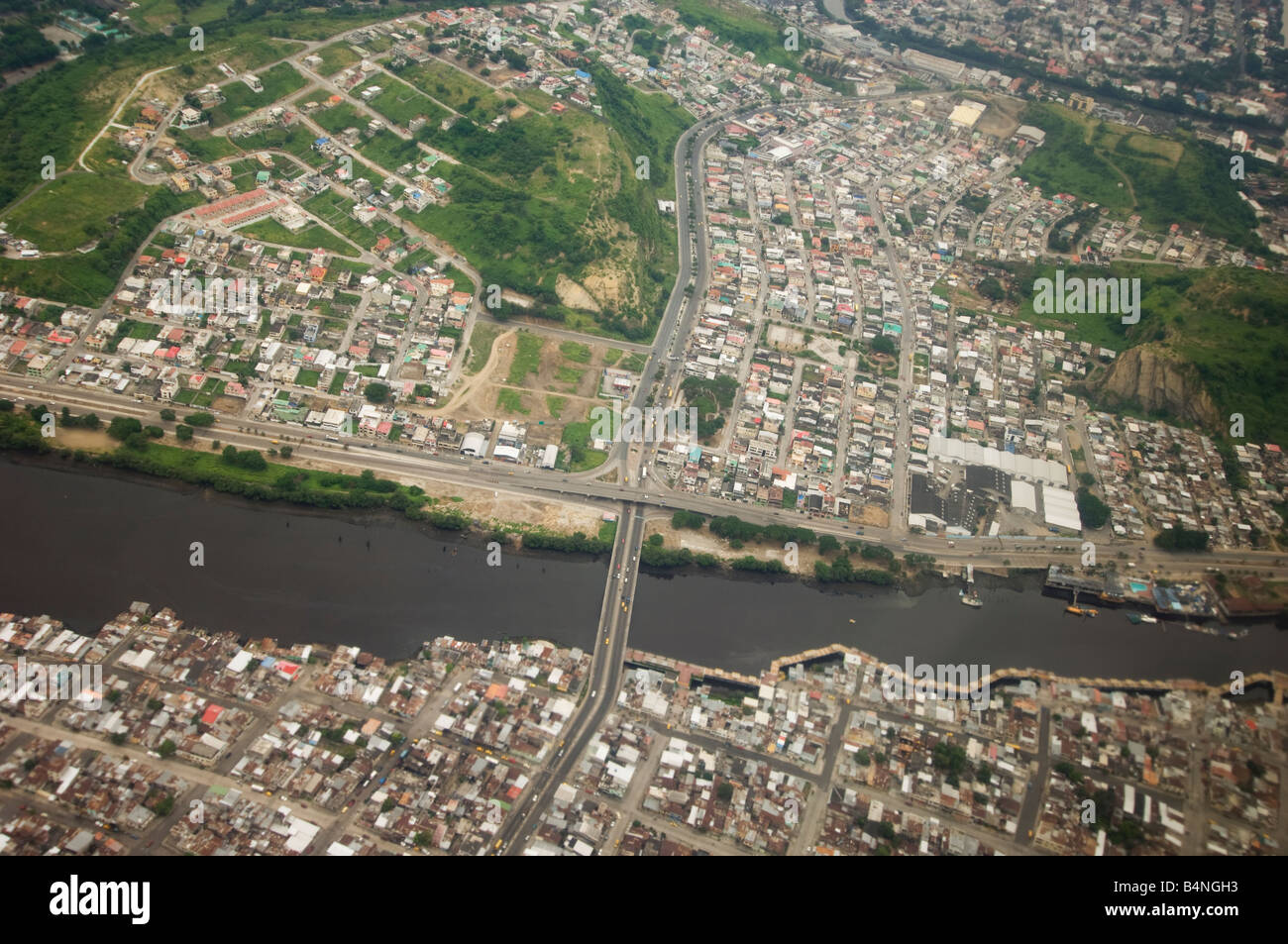 fly flying over overfly overflying Quaiaquil Ecuador city Equador Ecuador Overview cityscape urban birds eye view - Stock Image