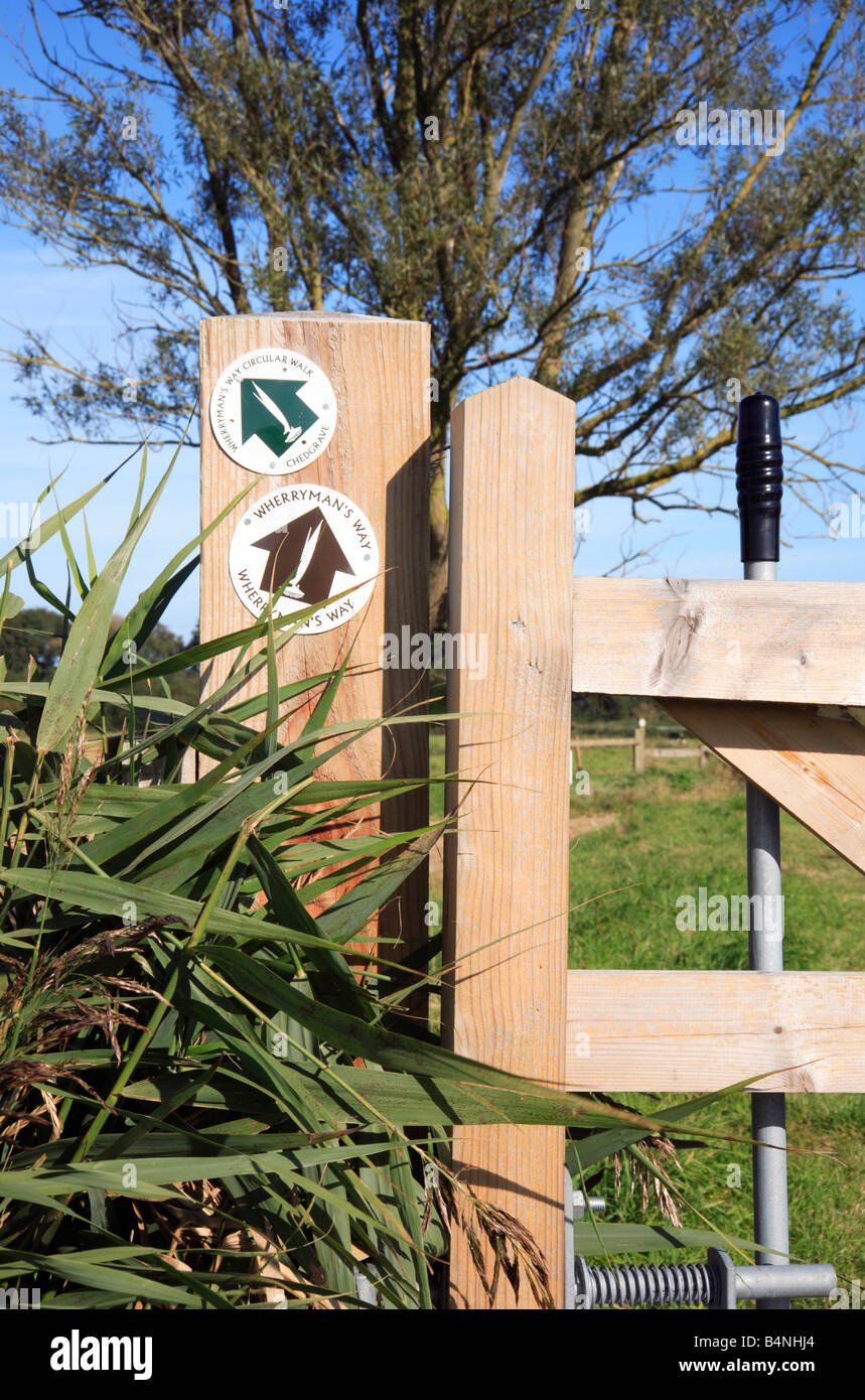 Direction signs on a gatepost for the Wherrymans Ways Circular Walk and the Wherrymans Way at Chedgrave, Norfolk, - Stock Image