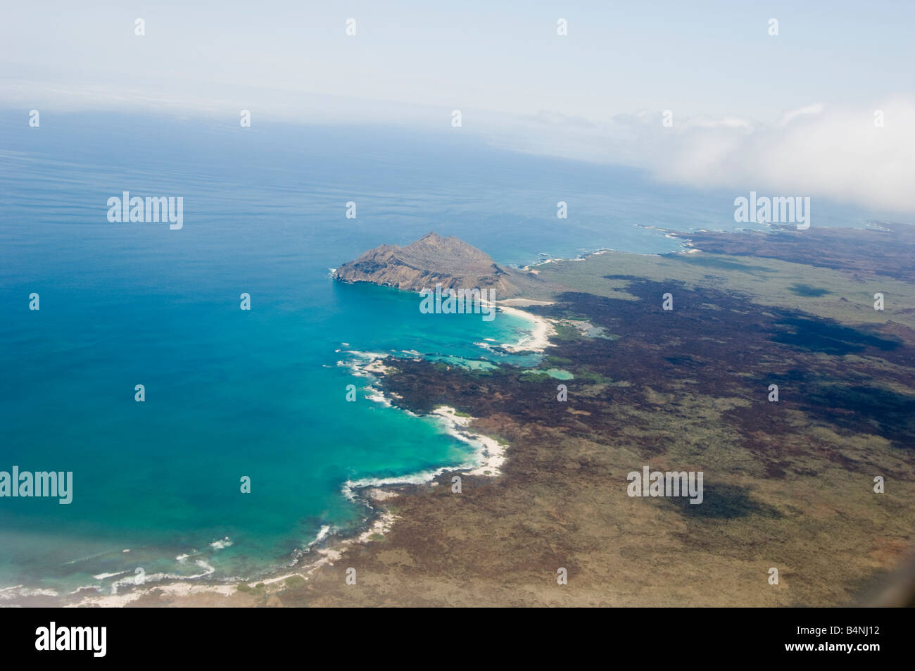 fly flying over overfly overflying Ecuador Equador coast sea water waves landscape aerial rain forest Overview birds - Stock Image