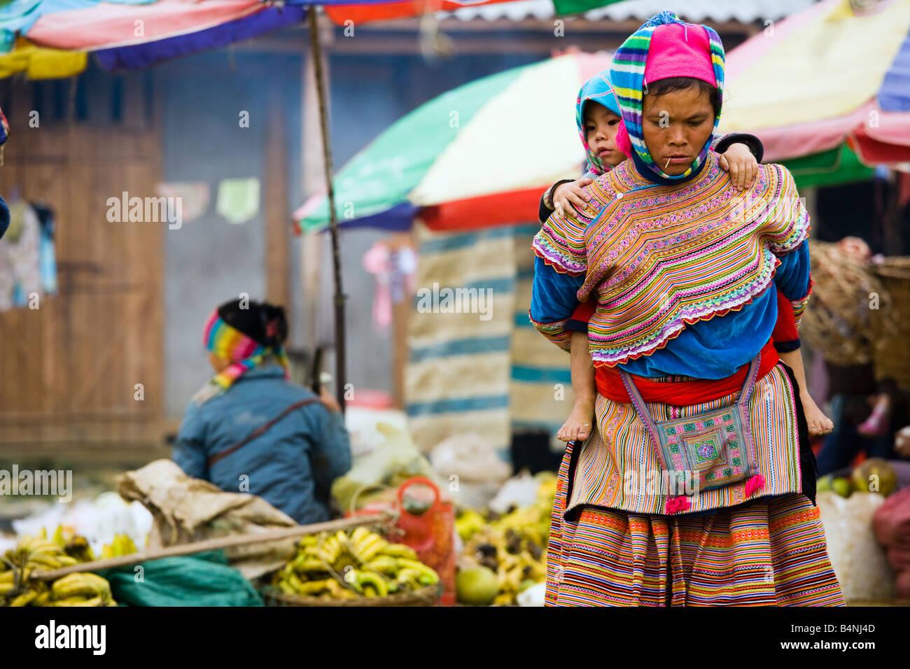 Flower Hmong woman at the Sunday market; Bac Ha, Vietnam Stock Photo