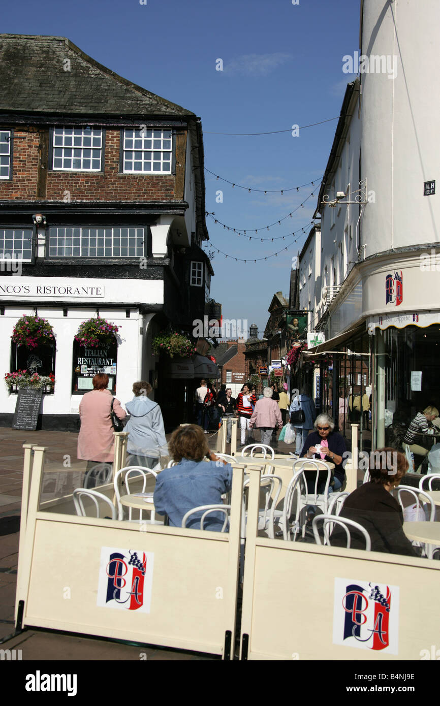 City of Carlisle, England. Shoppers and tourists enjoying lunch and refreshments at a restaurant in Fisher Street. - Stock Image