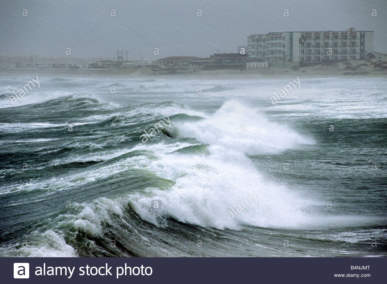 Waves crash on the beach as Hurricane Nora approaches the coast of Rocky Point Mexico   with beach front hotels - Stock Image