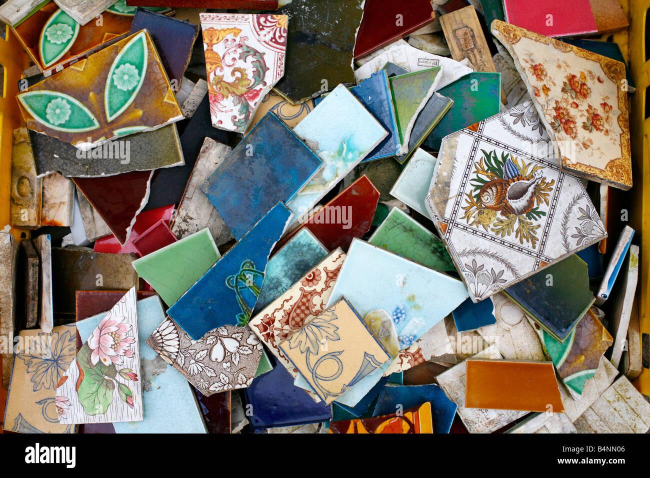 A box of antique ceramic tiles - Stock Image