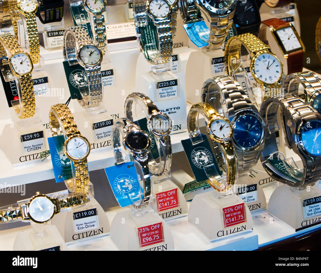 Wrist watches on display in the window of a Jewelery store UK - Stock Image