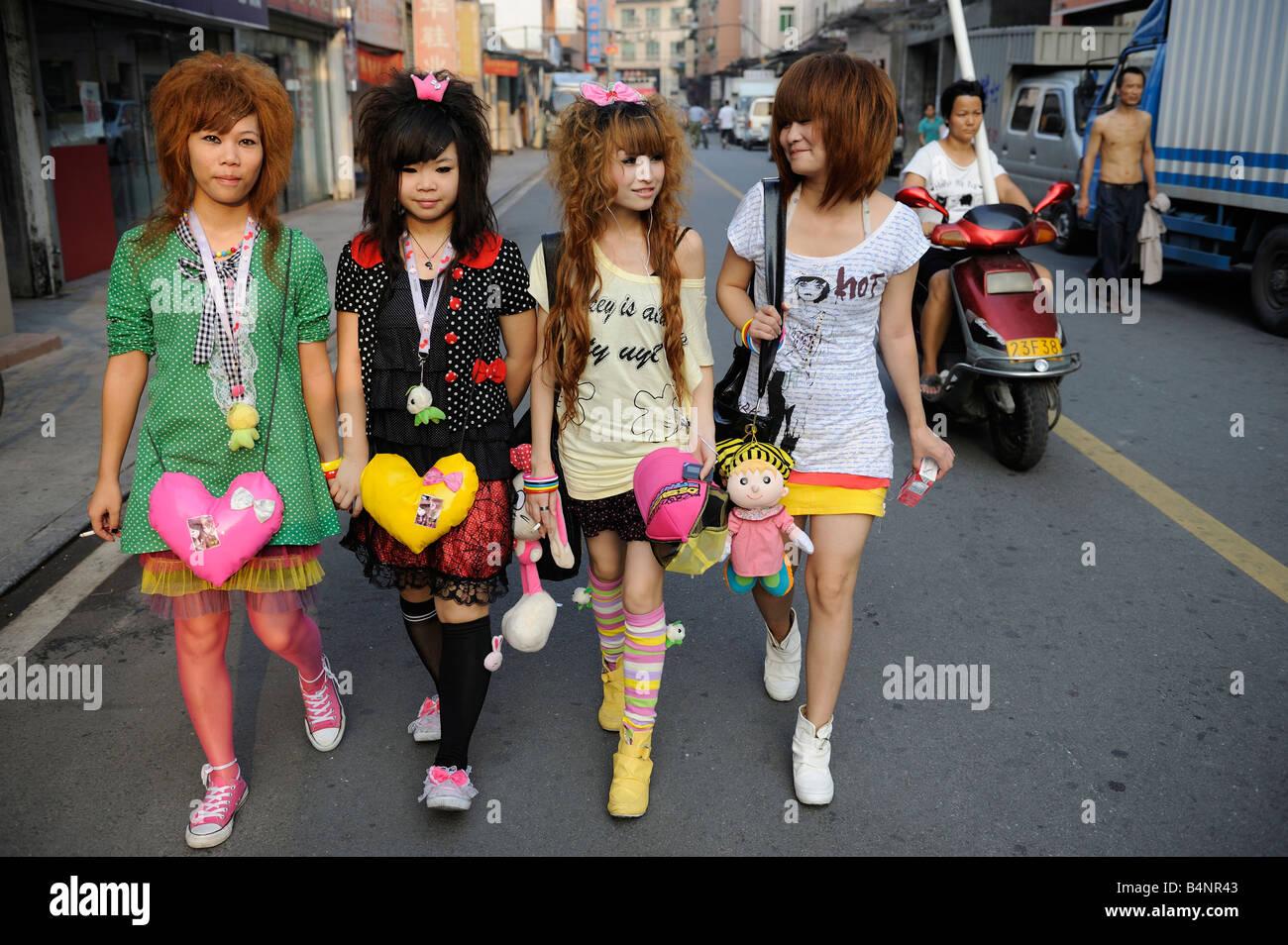 Four girls walking in a street in Dongguan, Guangdong, China. 20-Sep-2008 - Stock Image