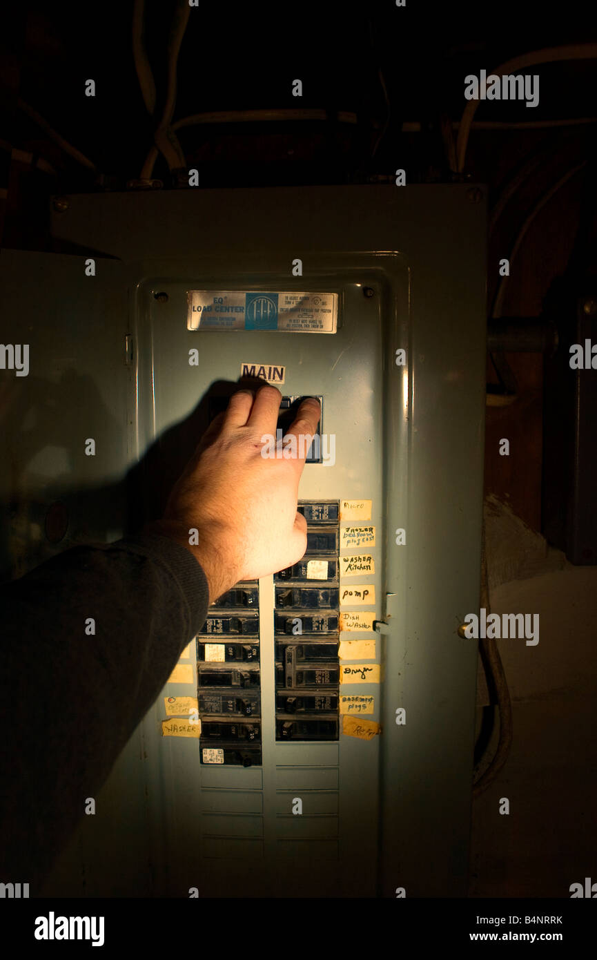 Fuse Box Circuit Breaker Stock Photos Trippingcircuitbreakerpaneljpg A Hand Reaches To Trip The Main In Illuminated With