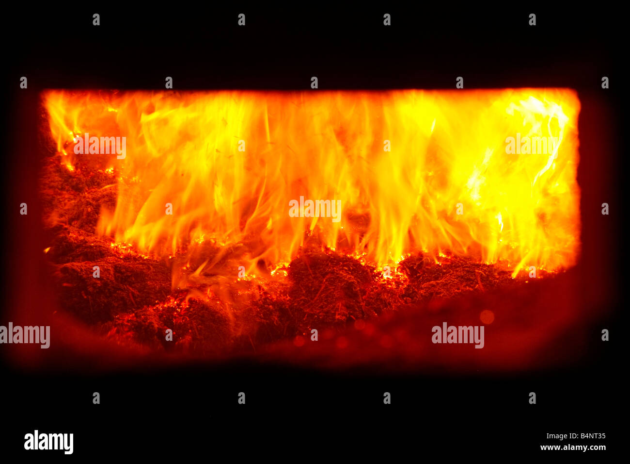 wood chippings burning in furnace, eco friendly electricity, flames, - Stock Image