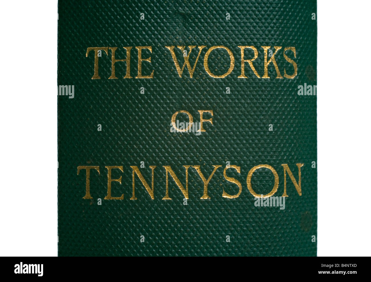 The name of the author Tennyson engraved in gold on the binding of an old book of his works - Stock Image