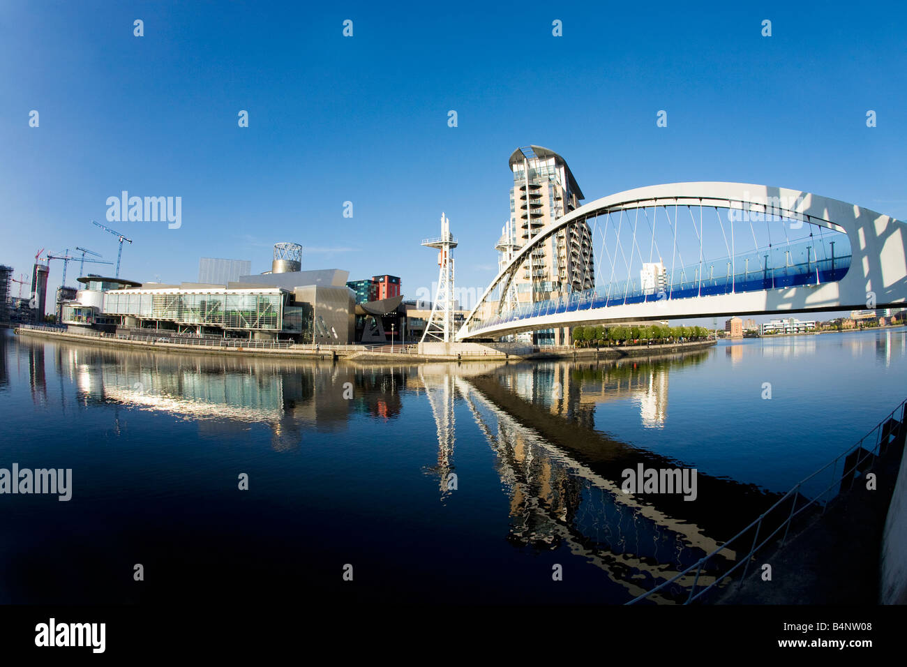 Millenium Bridge over Manchester Ship Canal and Lowry Art Centre Salford Quays Manchester Lancashire UK GB - Stock Image