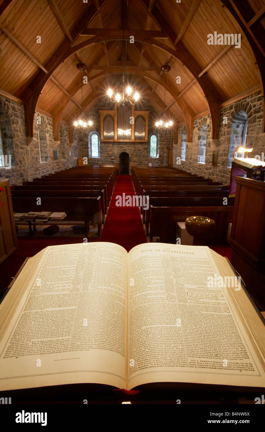 vicars view from the pulpit apse of a church looking over the holy bible down the aisle across the pews and absent Stock Photo