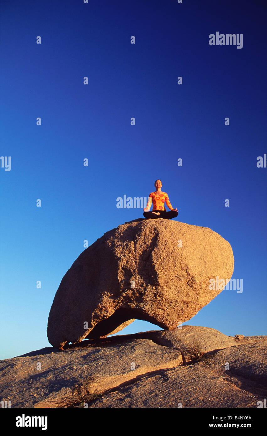 Algeria Djanet National Park Tassili n Ajjer UNESCO World Heritage site Woman meditating Sahara desert - Stock Image