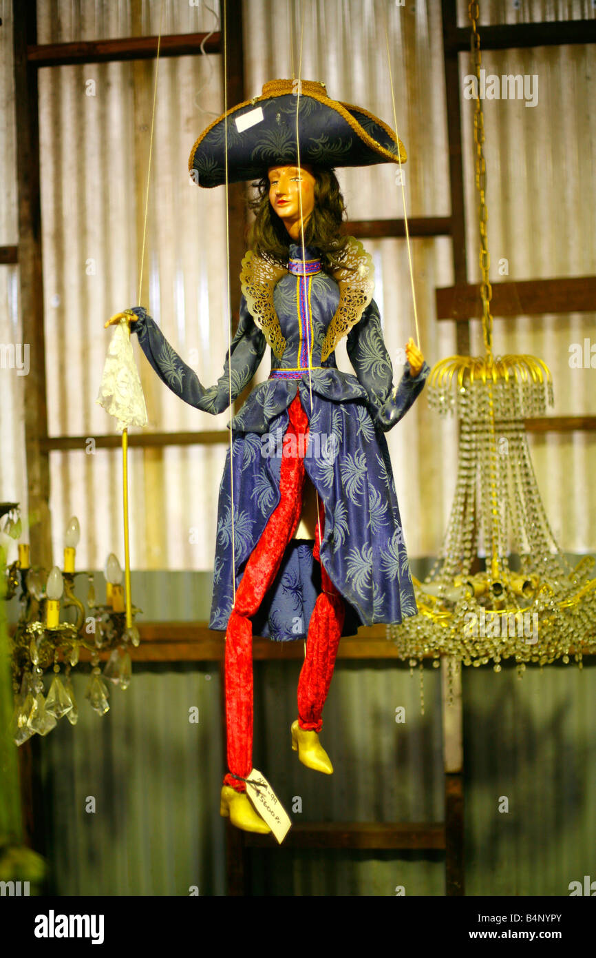 A beautiful puppet hangs amongst chandeliers for sale in a second a beautiful puppet hangs amongst chandeliers for sale in a second hand store aloadofball Choice Image