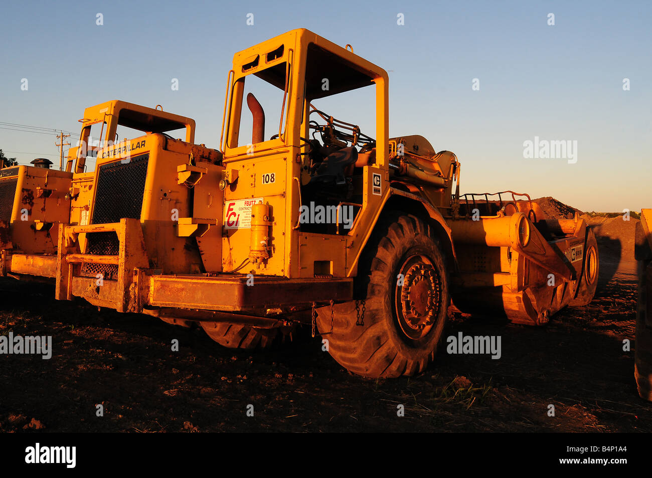 Cat or Caterpillar scraper or earth mover construction equipment - Stock Image