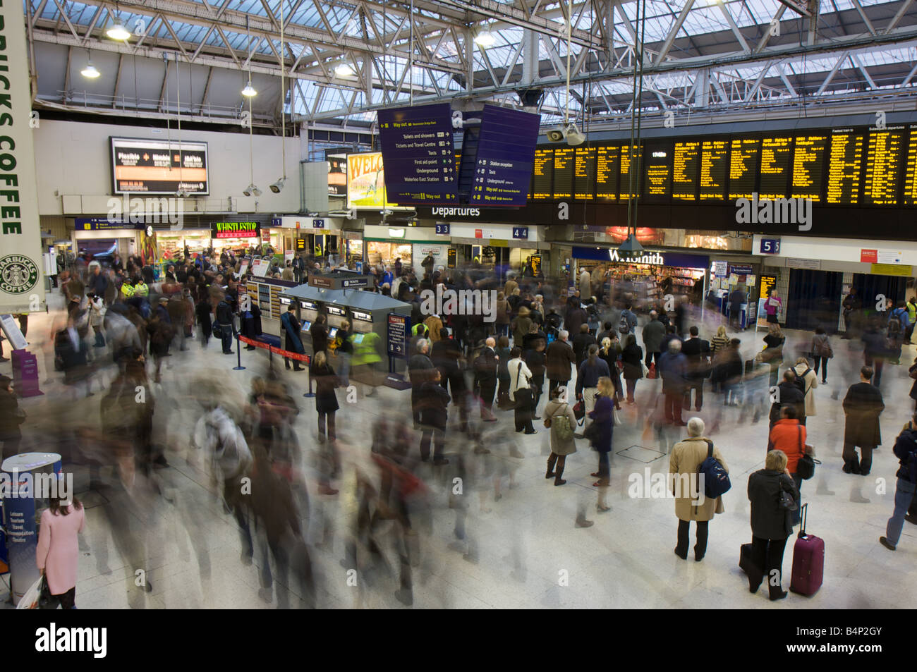 Blurred motion of commuters in London Waterloo Station, Waterloo, London, UK - Stock Image