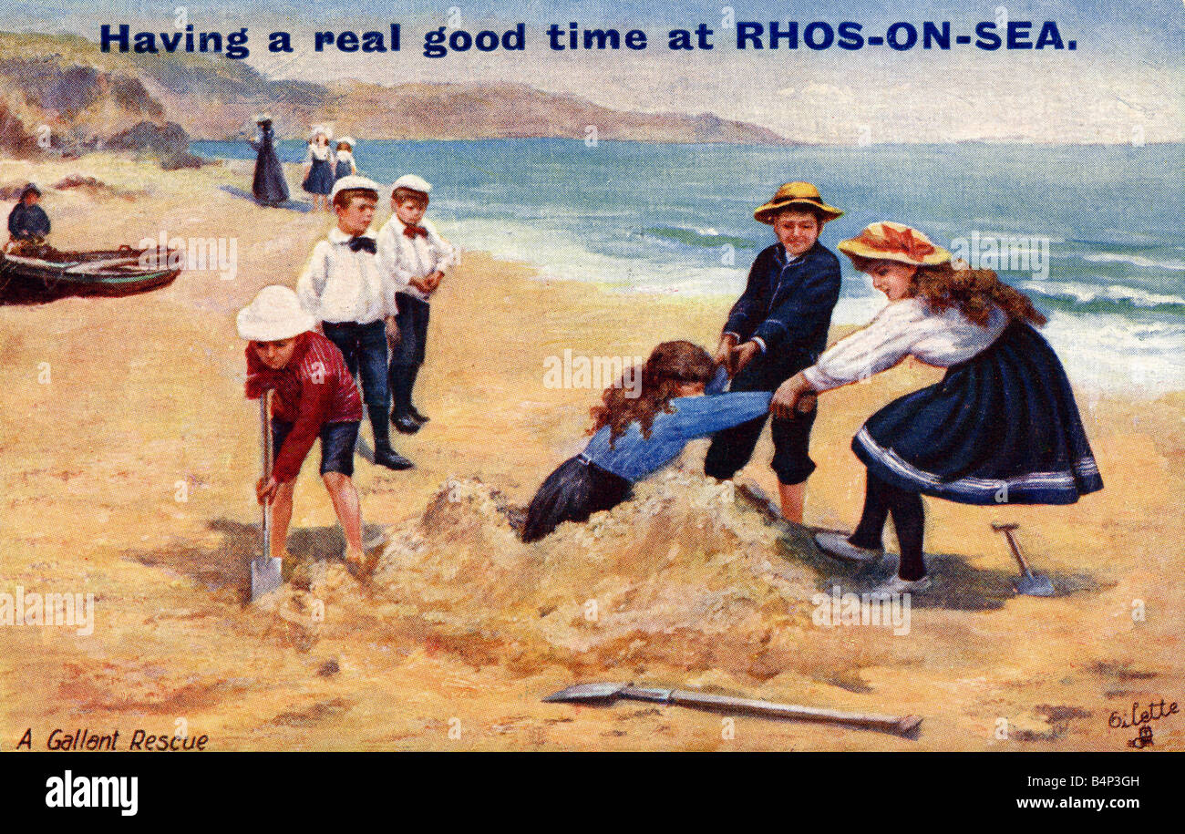 'Fun On The Sands' Old vintage Seaside British Picture Postcard  Rhos on Sea FOR EDITORIAL USE ONLY - Stock Image