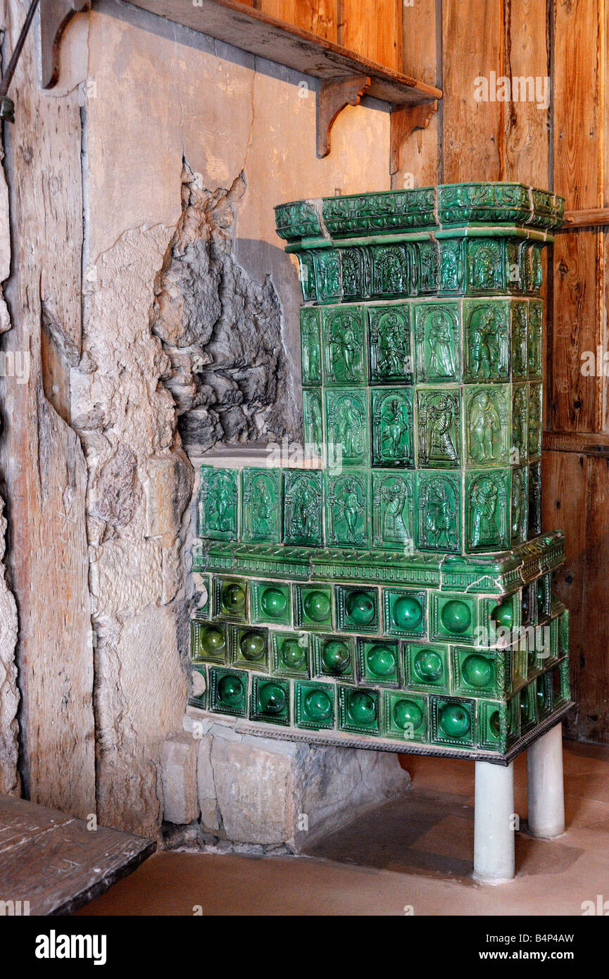 tiled stove in the luther chamber in the wartburg museum, Eisenach, Germany. - Stock Image