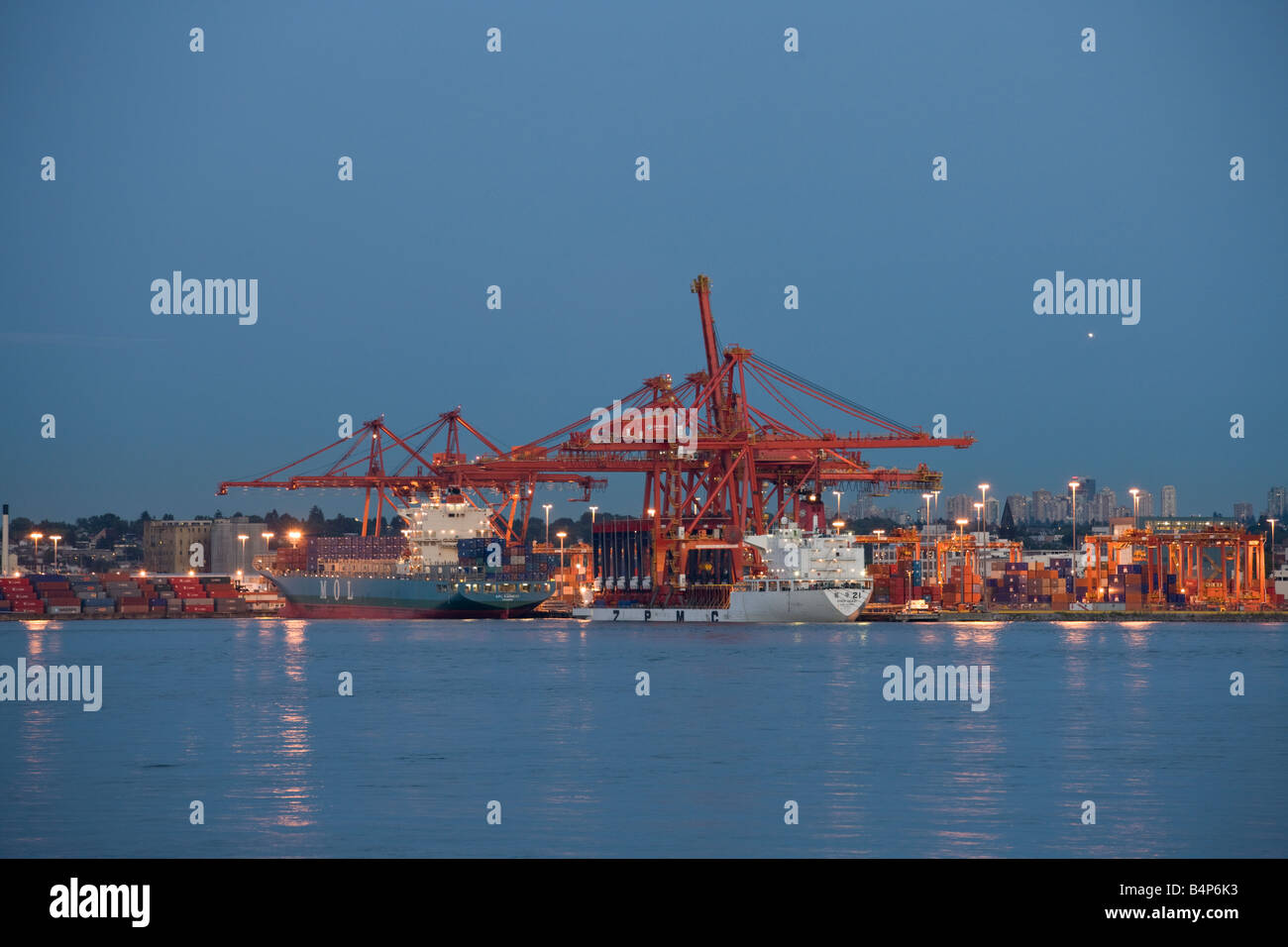 APL Earnest and Zhen Huazi container ships at dock in Vancouver harbor, British Columbia, Canada - Stock Image
