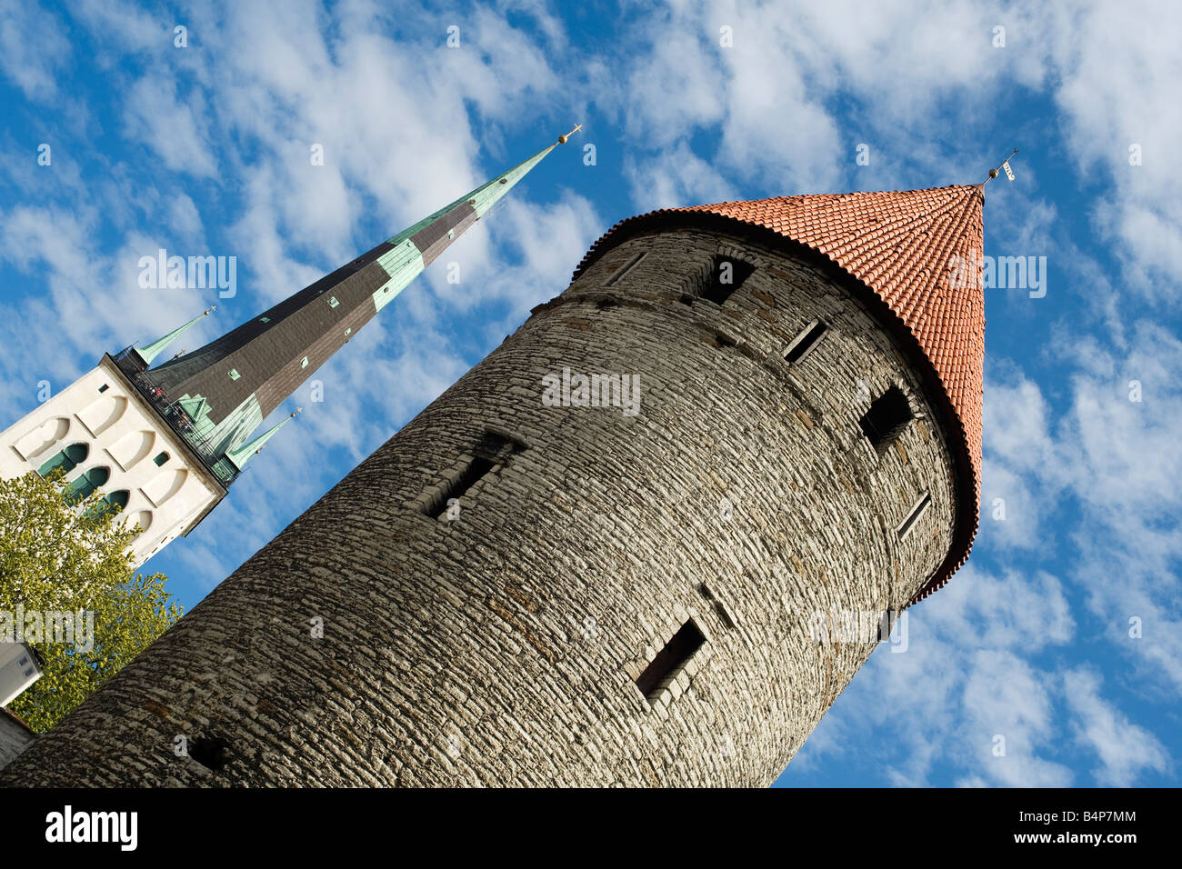 Town wall tower and church of St. Olaf steeple, old town, Tallinn, Estonia - Stock Image