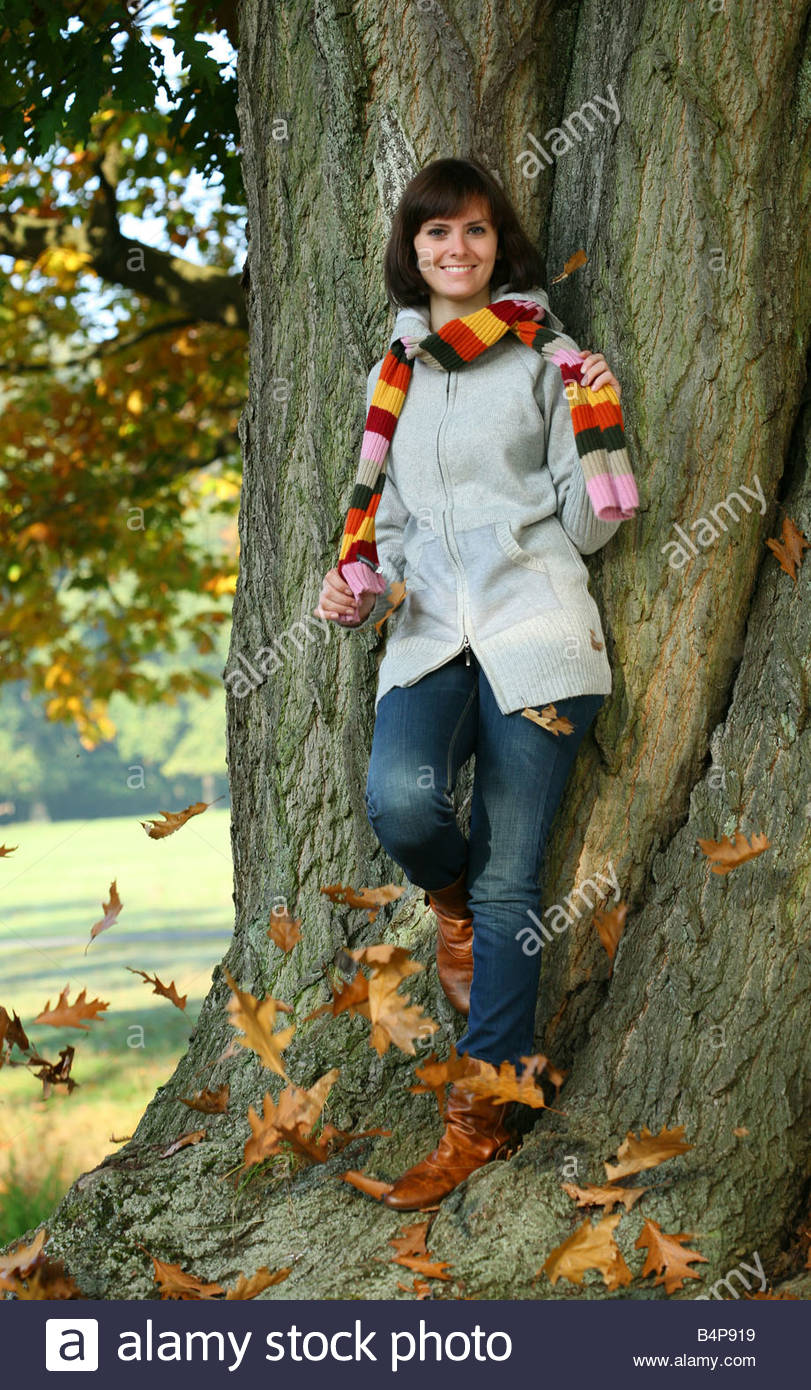young woman resting during a walk in autumn landscape - Stock Image