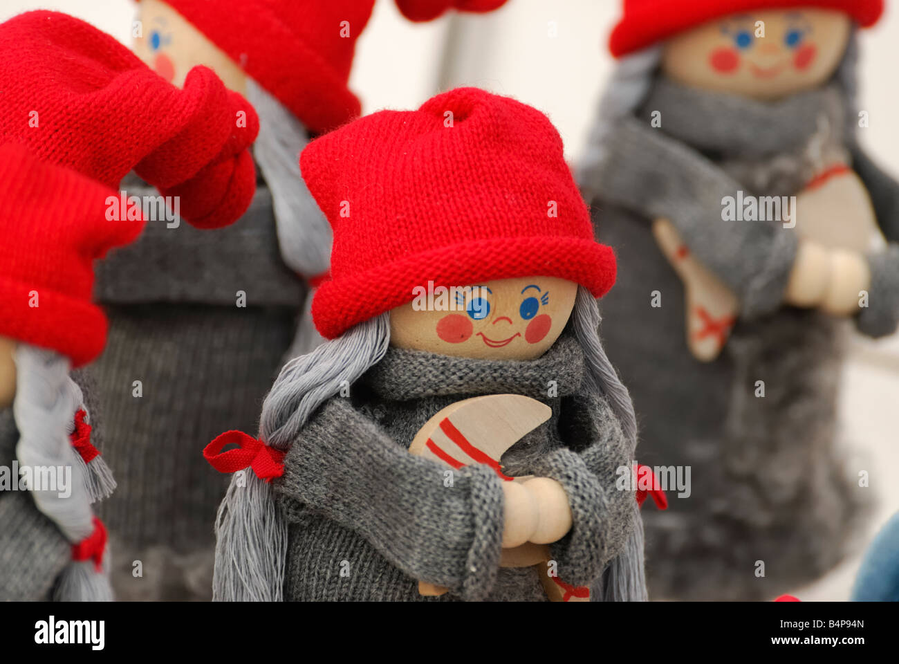 Finnish dolls in red caps Helsinki Finland - Stock Image