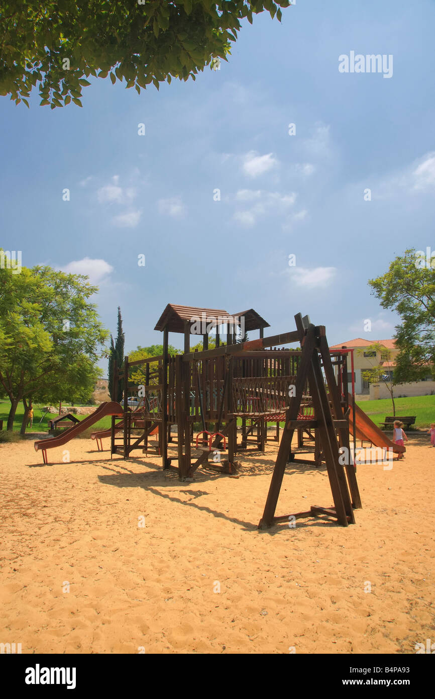 A playgarden for kids in the sand. A Horizonal of this picture is ref. B4TYM4 - Stock Image