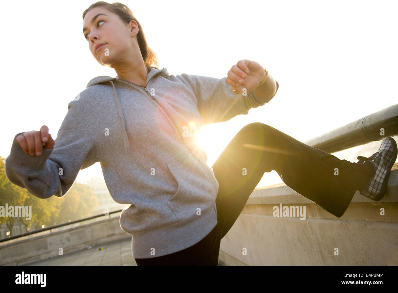Woman Stretching Before Excercise - Stock Image