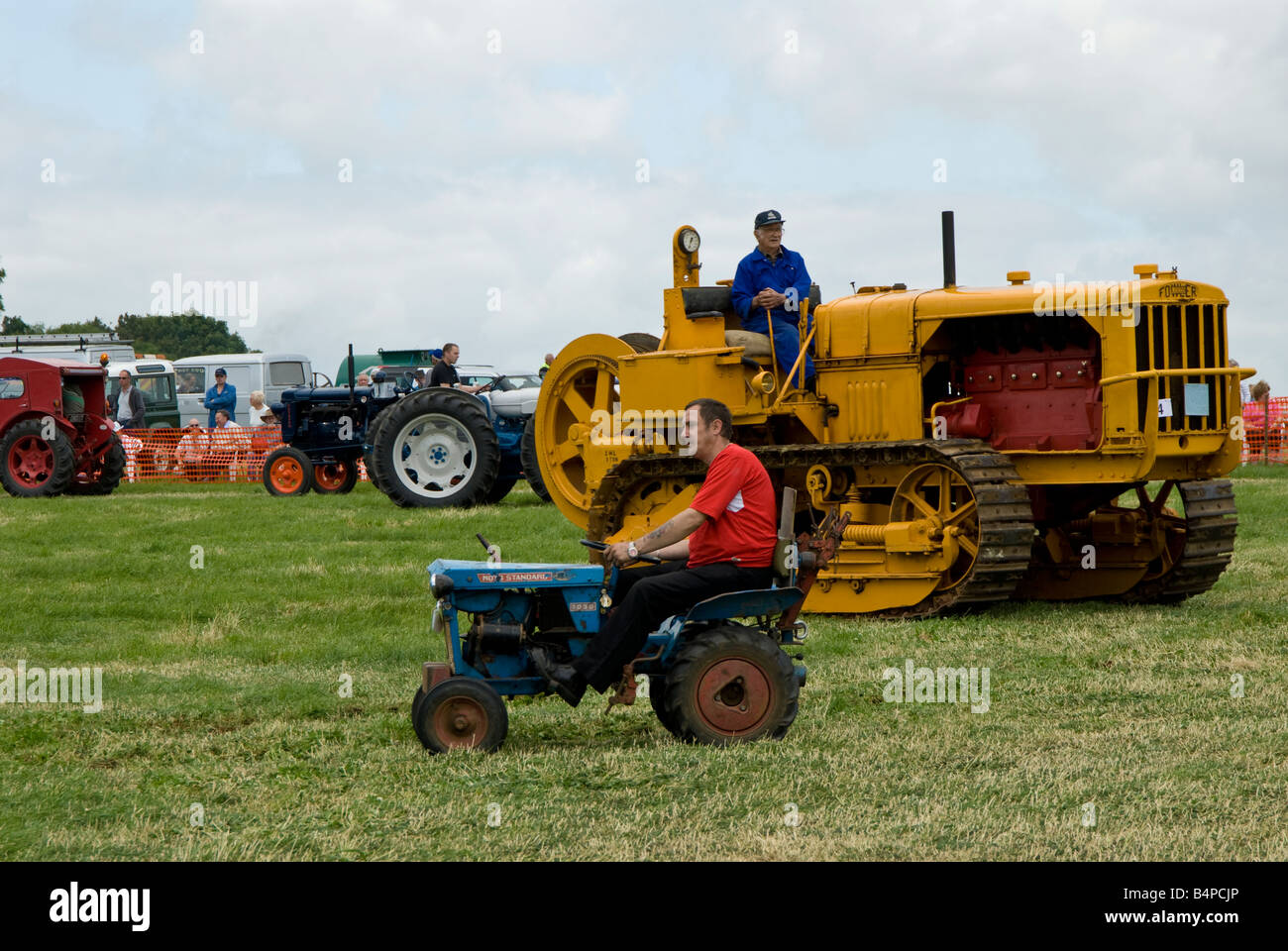 A Moto Standard mini tractor and Fowler caterpillar tracked vehicle at Bloxham Vintage Vehicle Show. UK - Stock Image