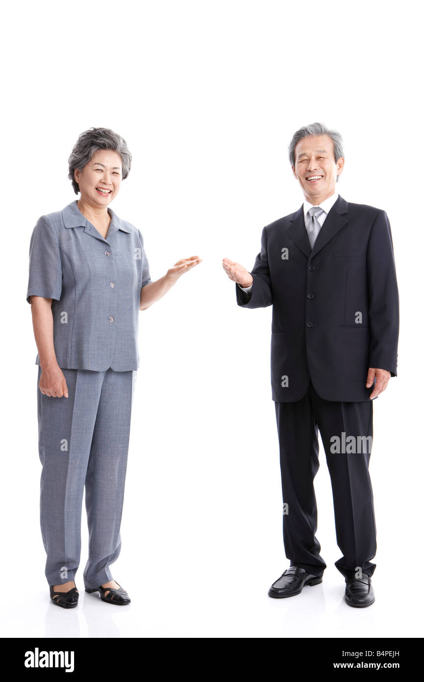 Mature couple smiling, portrait - Stock Image
