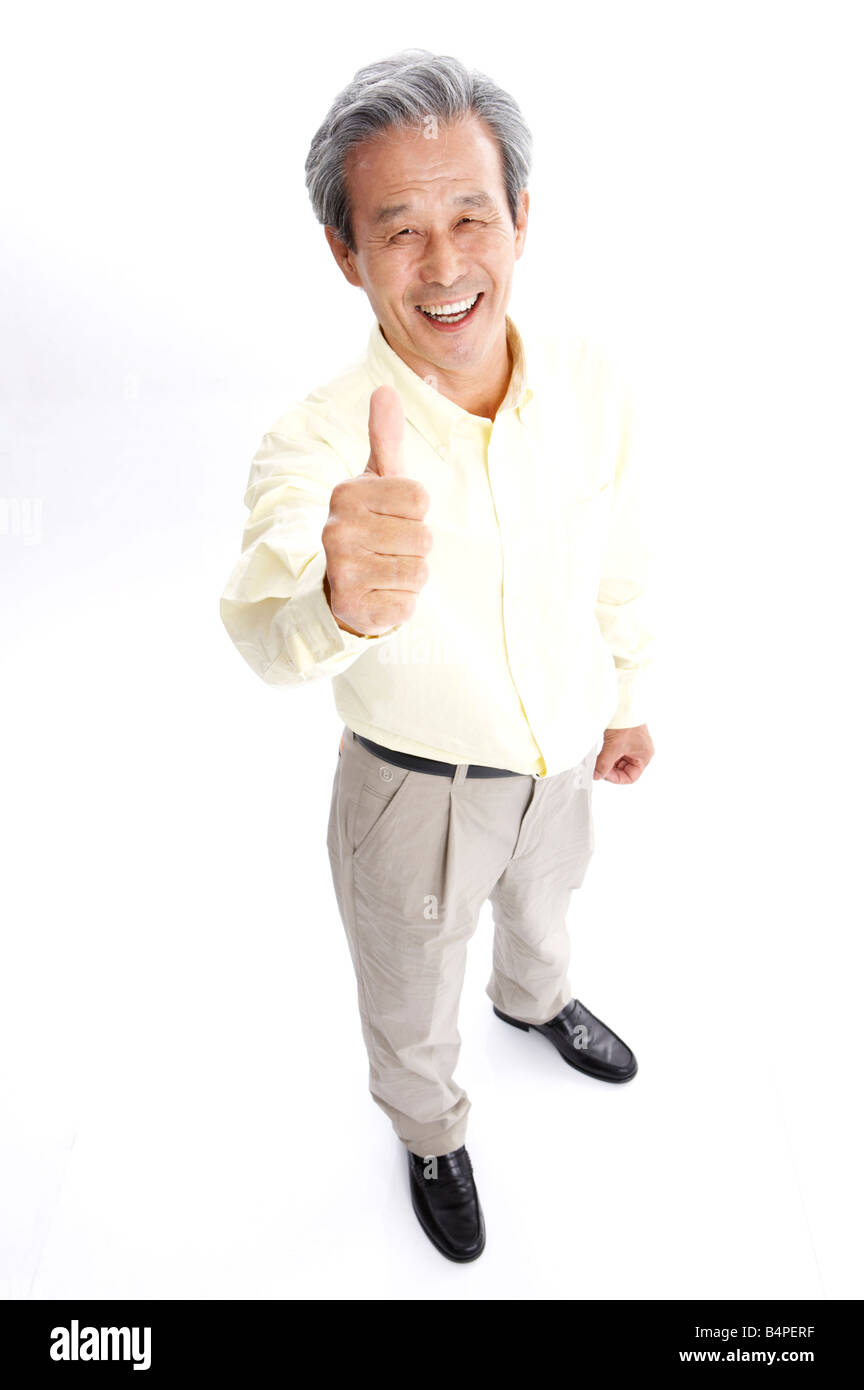 mature man showing thumbs up, smiling, portrait stock photo