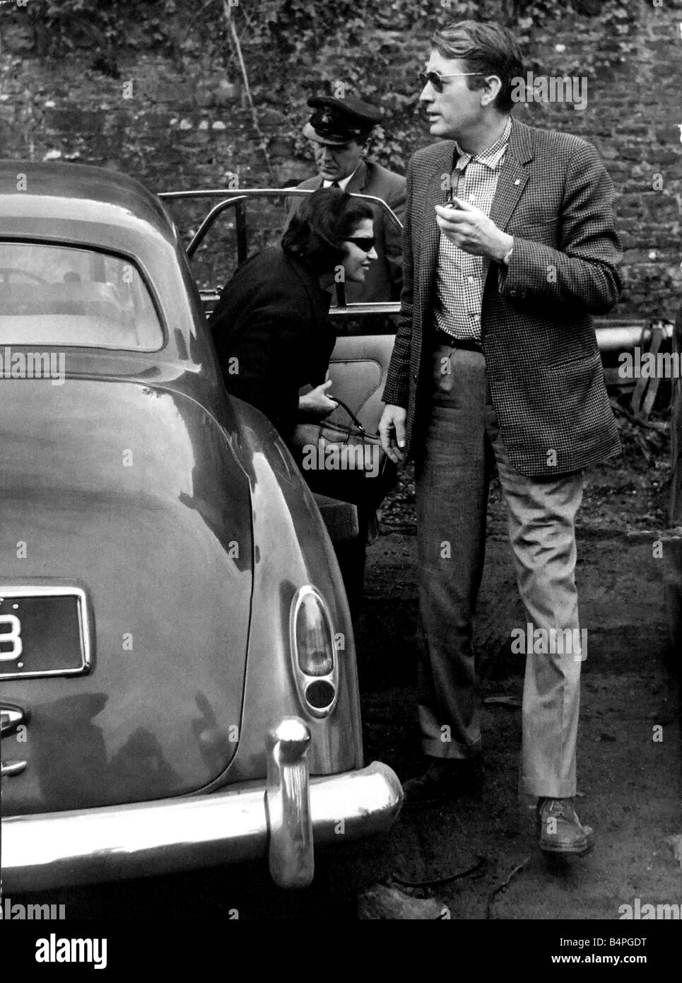 Film star Gregory Peck is pictured arriving at Crumlin yesterday where he is filming scenes for the film Arabesque - Stock Image
