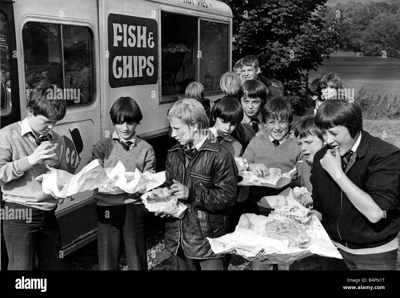 Chip with everything Pupils of King Henry VIII School Abergavenny with their meals bought from fish and chip van - Stock Image