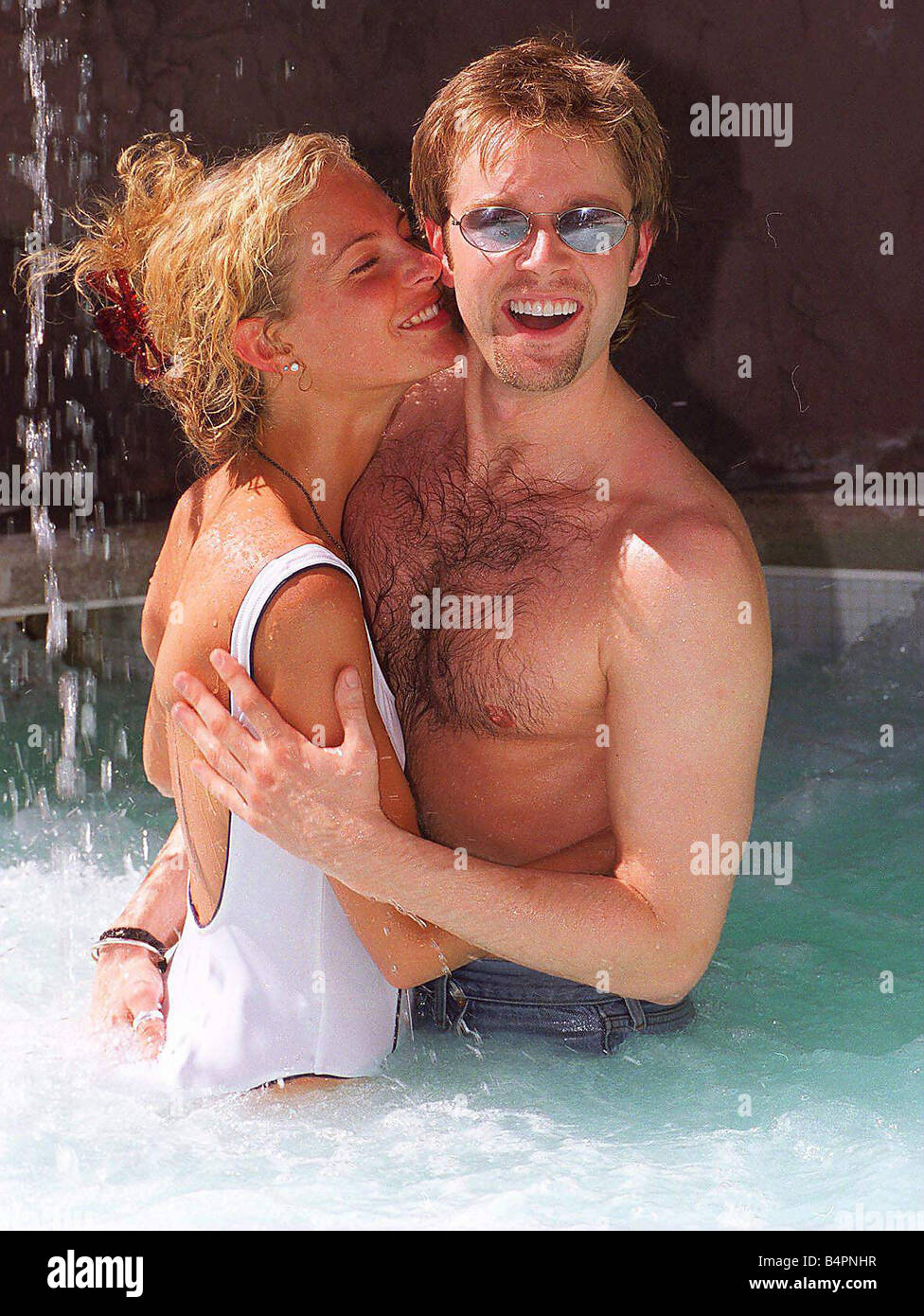 Darren Day and Tracey Shaw frolic in the pool in Las Vegas - Stock Image