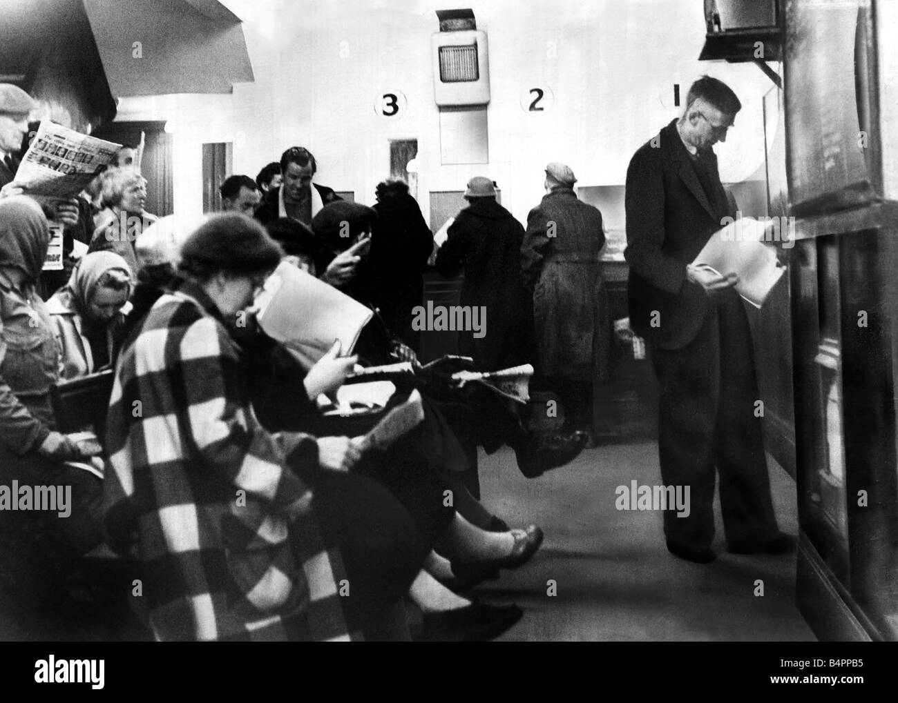 Punters placing their bets at the betting shop May 1958 - Stock Image