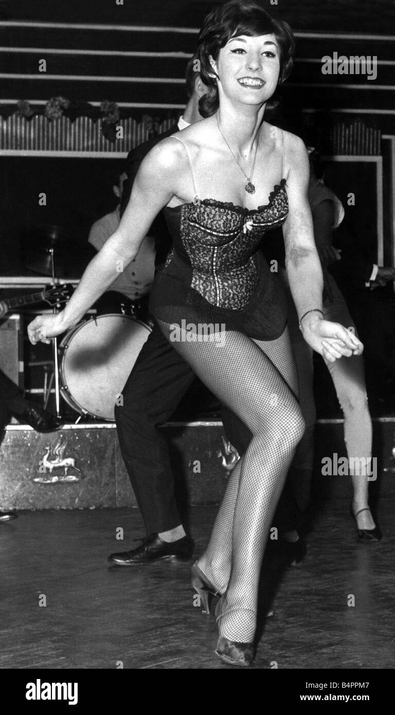 Sandra Gordon aged 18 demonstrates the Twist Showgirls at the Whiksy a Gogo in Wardour Street London had a new dance - Stock Image