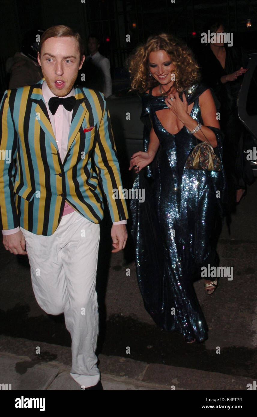 Kate Moss S 30th Birthday Party Arriving With A Man In Striped Blazer And Bow Tie Wearing Sparkling Long Low Cut Blue Dress
