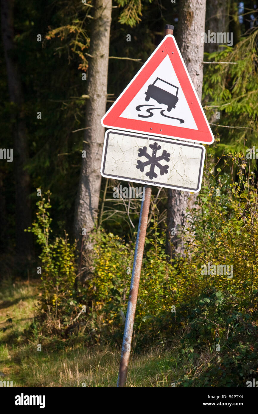 Slippery road sign snow, Bergishes land, Germany. - Stock Image