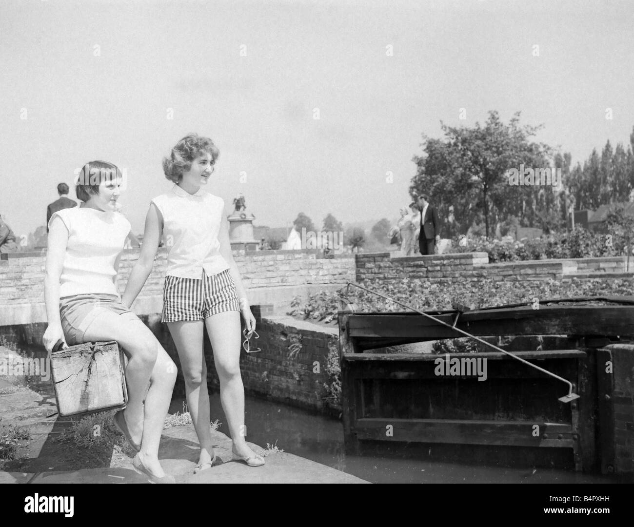 Sitting on the lock gate in the Bancroft gardens Stratford is a popular tourist attraction And most of them are - Stock Image