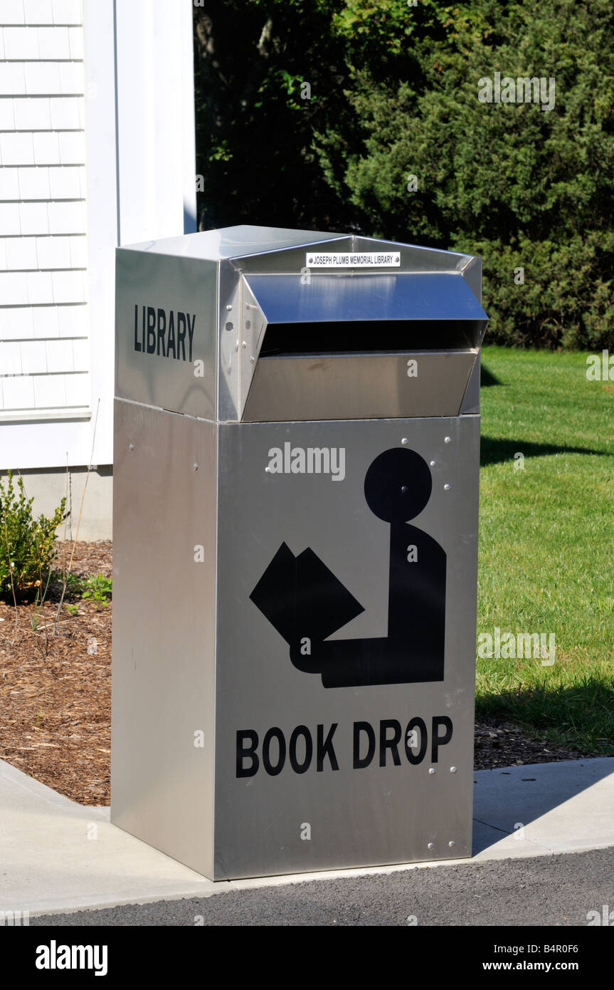 Shiny metal Library book deposit drop box receptacle outside with slot - Stock Image