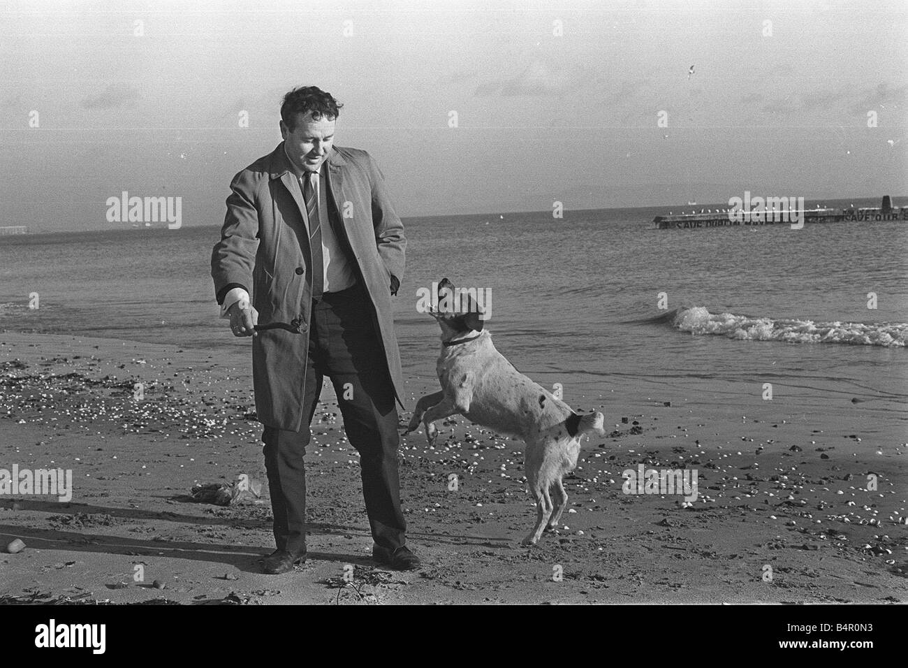 Sean Bourke who helped double agent George Blake escape to Russia playing with his dog beside the sea 23 1 69 Z754 - Stock Image